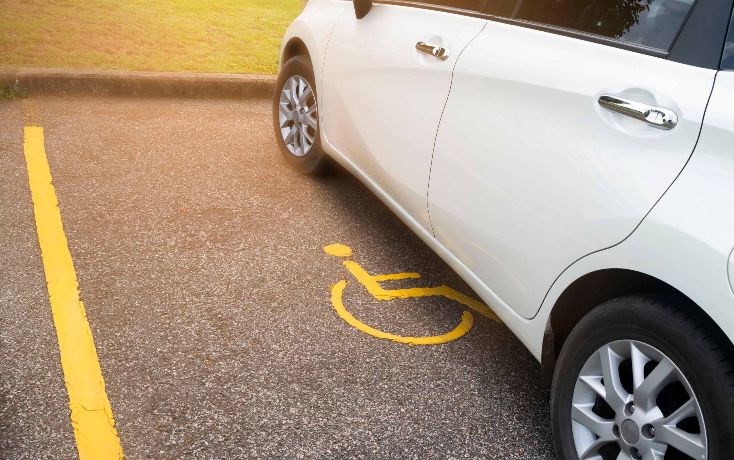 white car park in a marked disabled bay