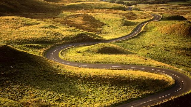 Winding country road through hilly countryside