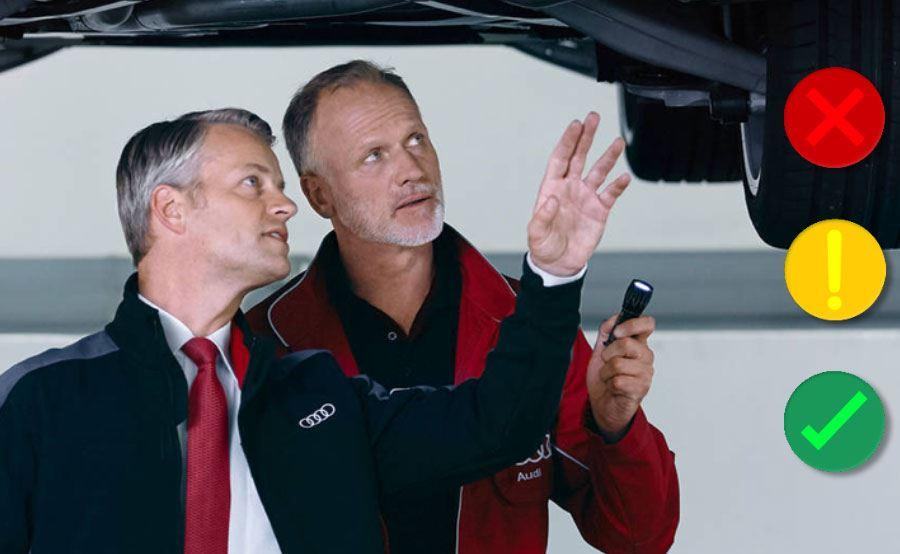 Audi Health Check image showing two technicians