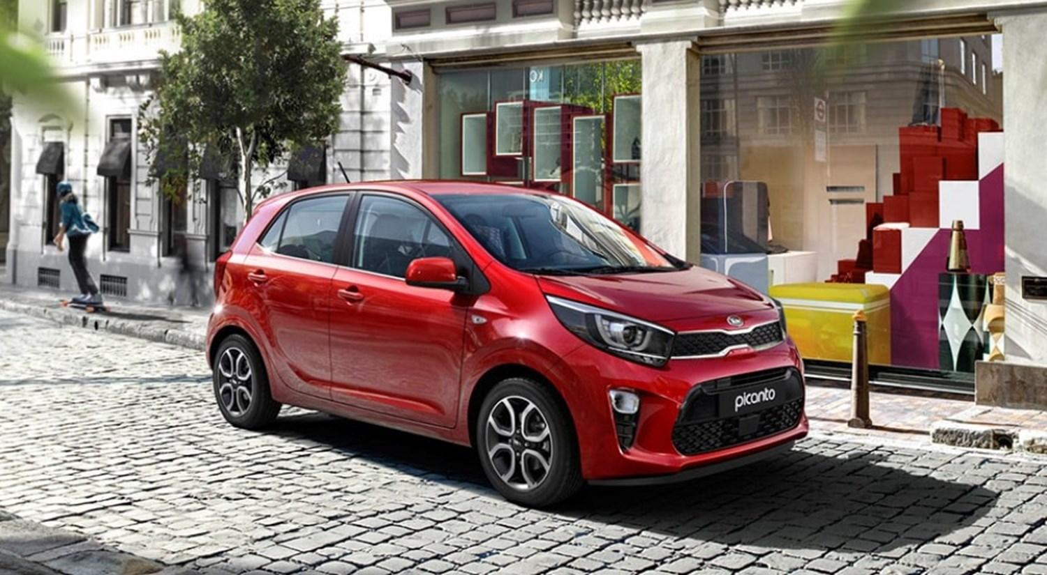 Red Kia Picanto parked on cobbled street