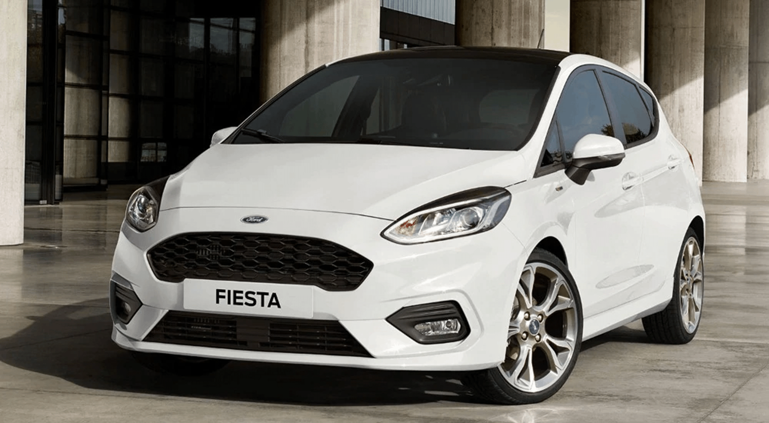 White Ford Fiesta parked on tiles