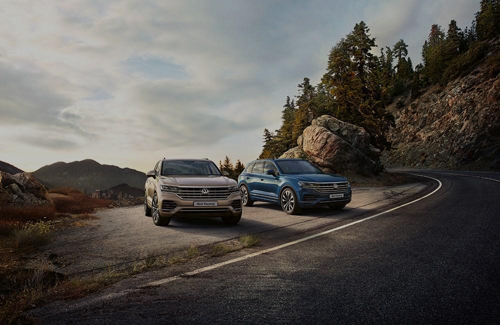 Volkswagen Touaregs in hillside setting