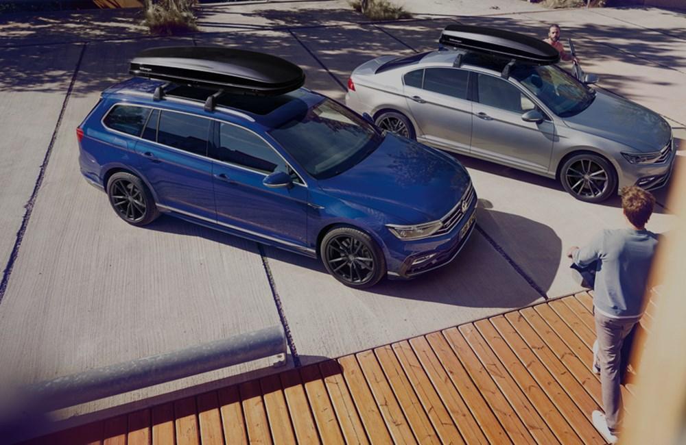 Blue Volkswagen Golf & Silver Volkswagen Arteon with roof racks