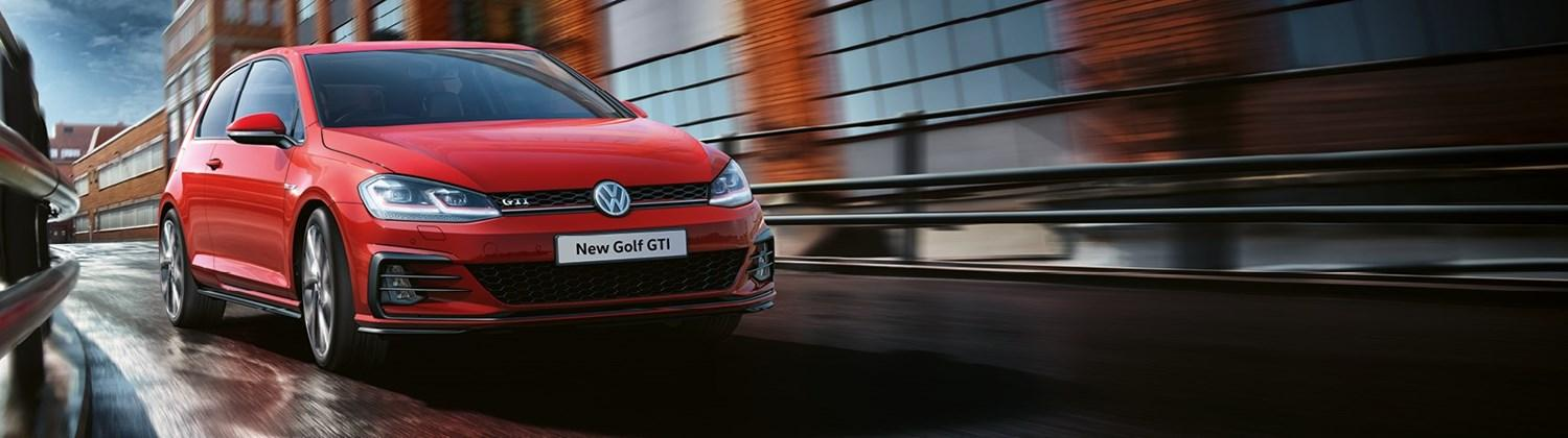 Red Volkswagen Golf GTI from the front