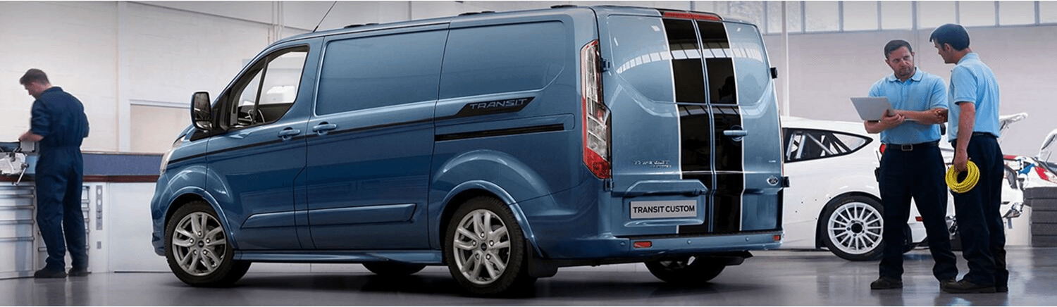 Ford Transit in a garage with engineers