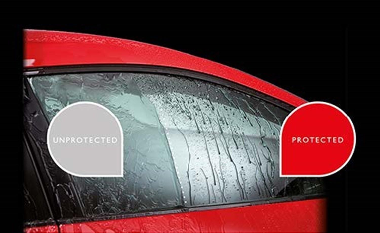 Red car's window with half protected by Life Shine and half unprotected