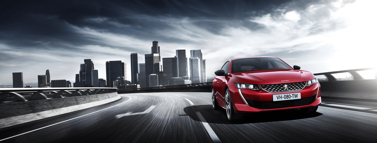 Front facing Red Peugeot 508 driving on road