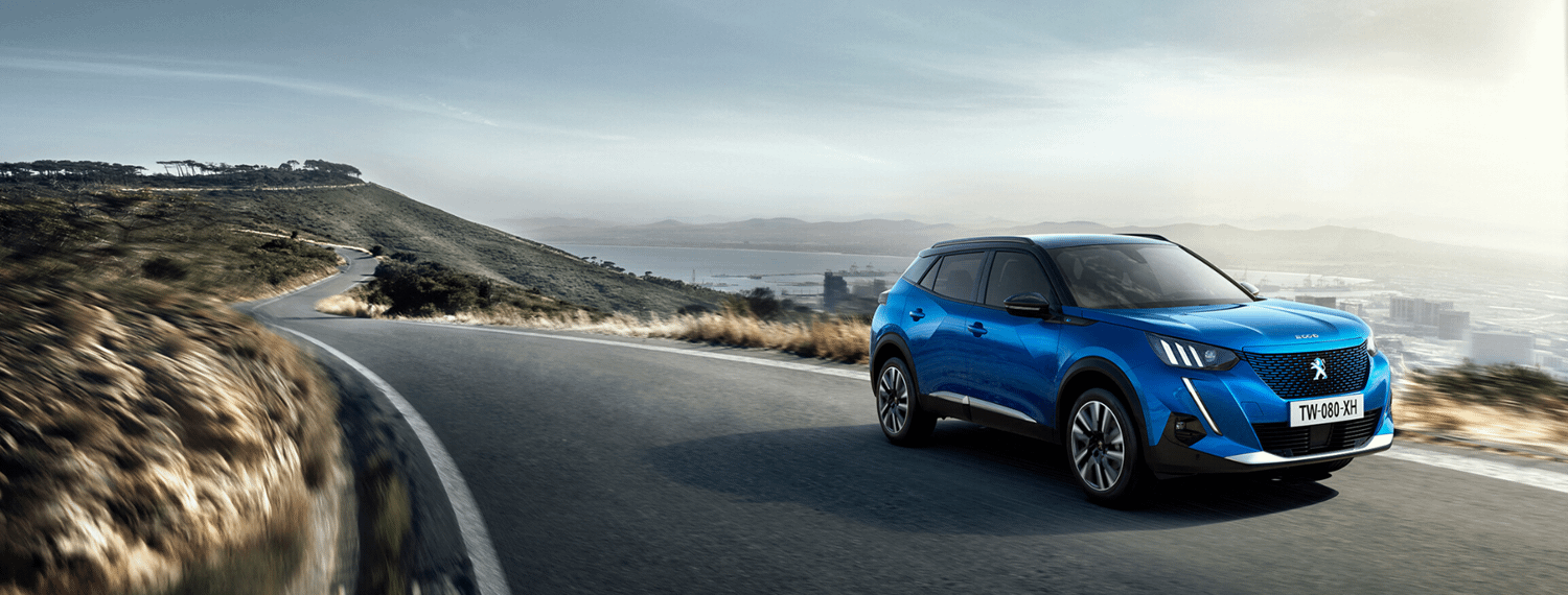 Blue All-New Peugeot 2008 SUV driving through hills