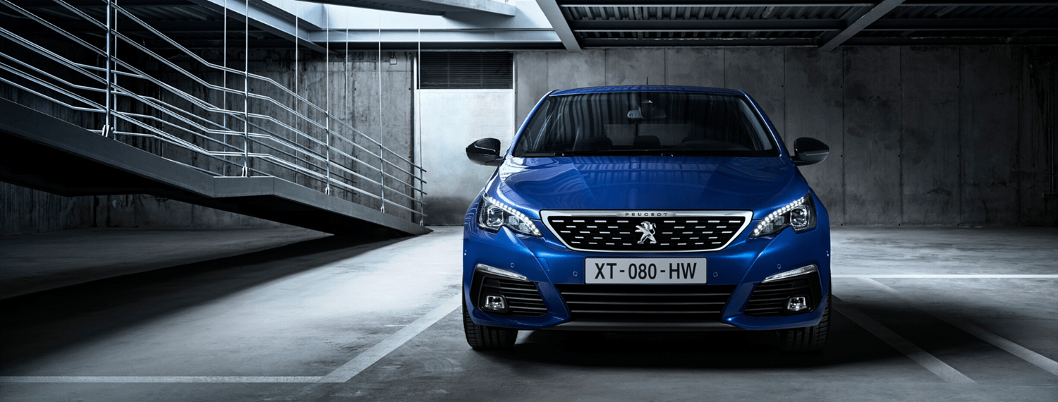 Front facing Blue Peugeot 308 parked in underground car park