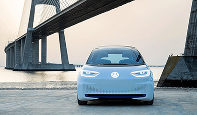 White Volkswagen ID in front of a bridge
