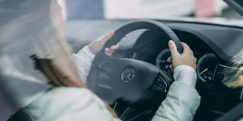 Woman behind Skoda steering wheel