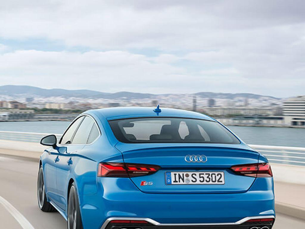 S5 Coupe in blue driving rear view