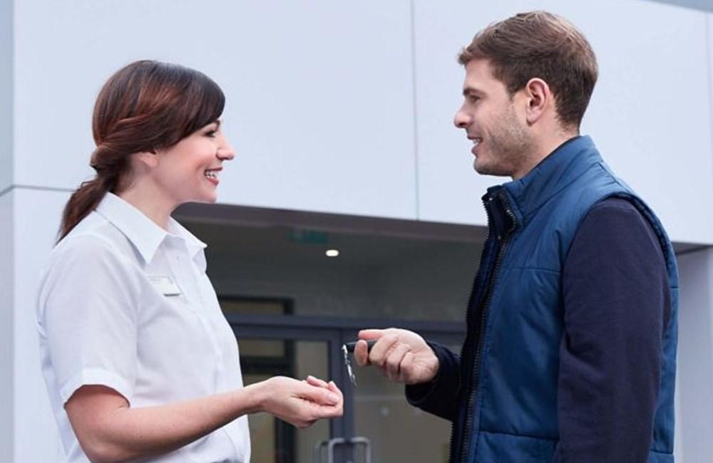 Man and women exchanging car keys