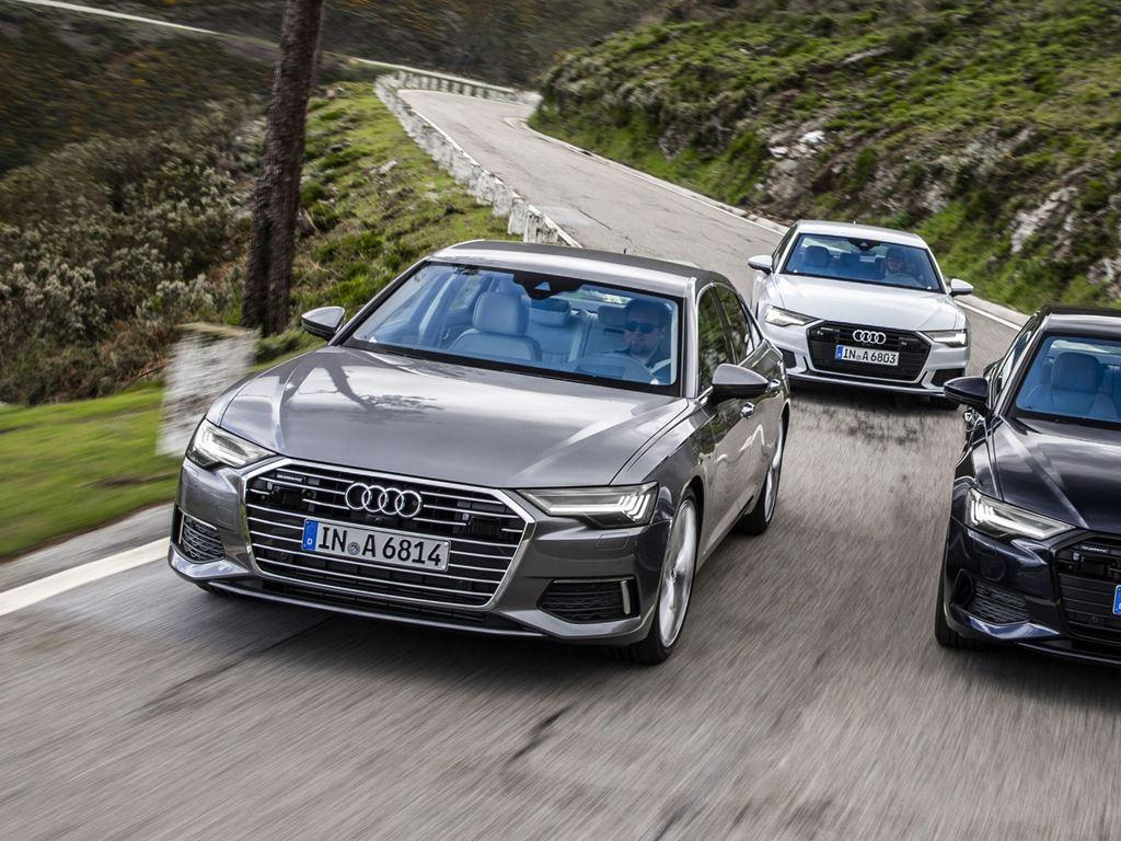 Three A6 Saloons driving