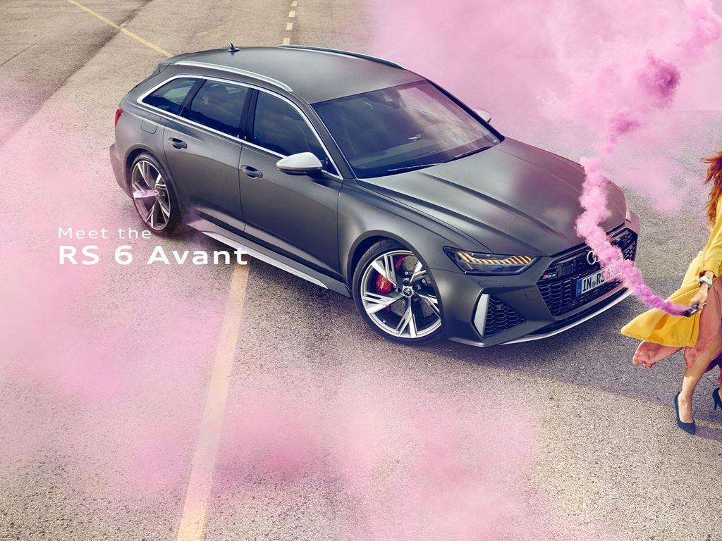 RS6 Avant with two people with a pink smoke grenade