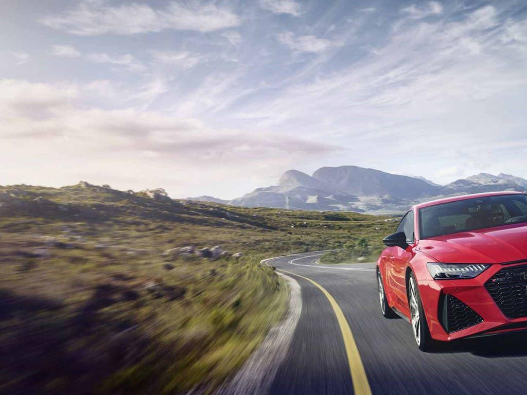 RS 7 Sportback in red driving on open road