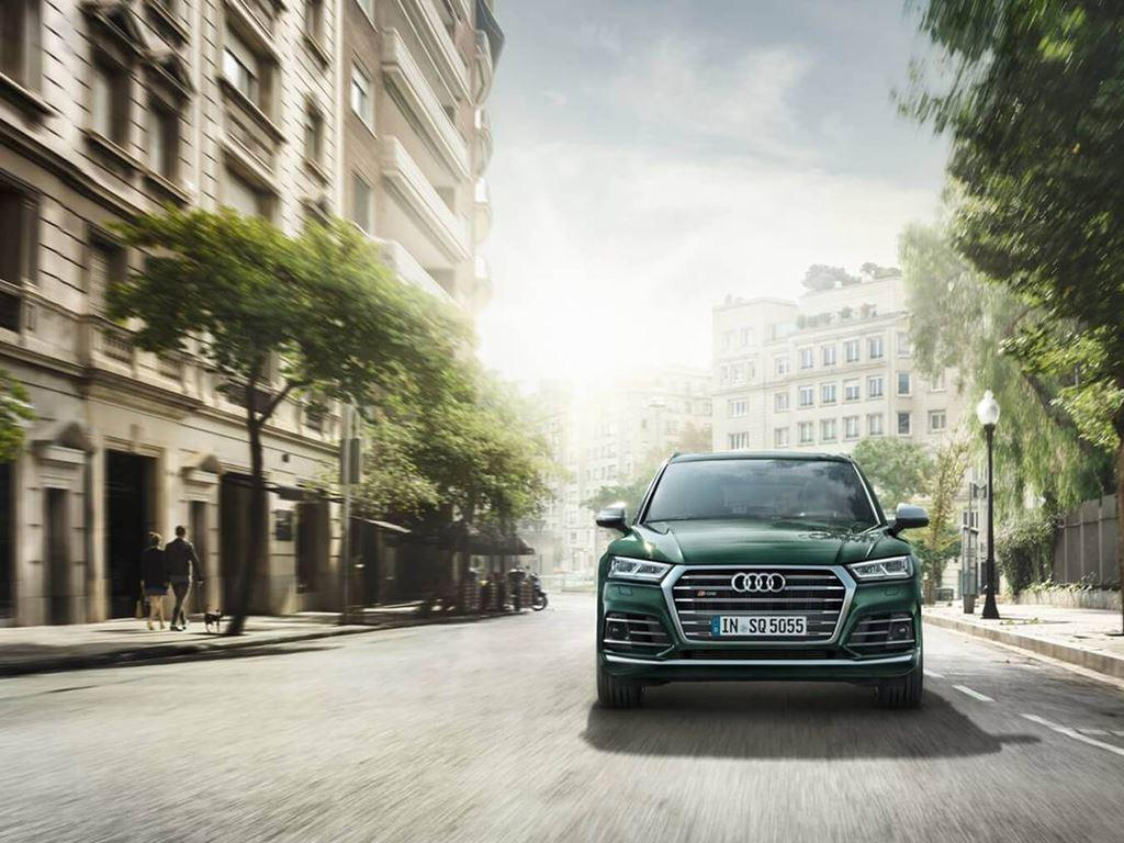 Front grille and headlights of green sq5 on the road