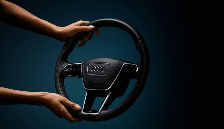 Audi steering wheel being held