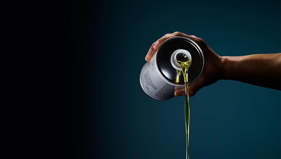 Audi oil being poured out of a can