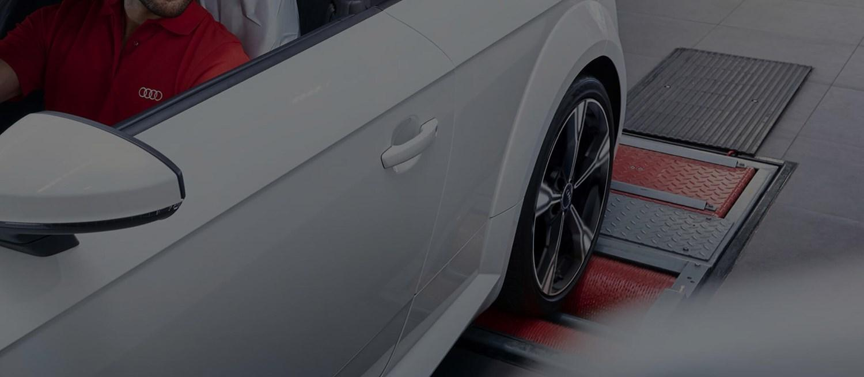White Audi in bodyshop