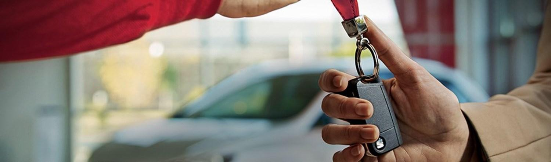 Two people exchanging car keys
