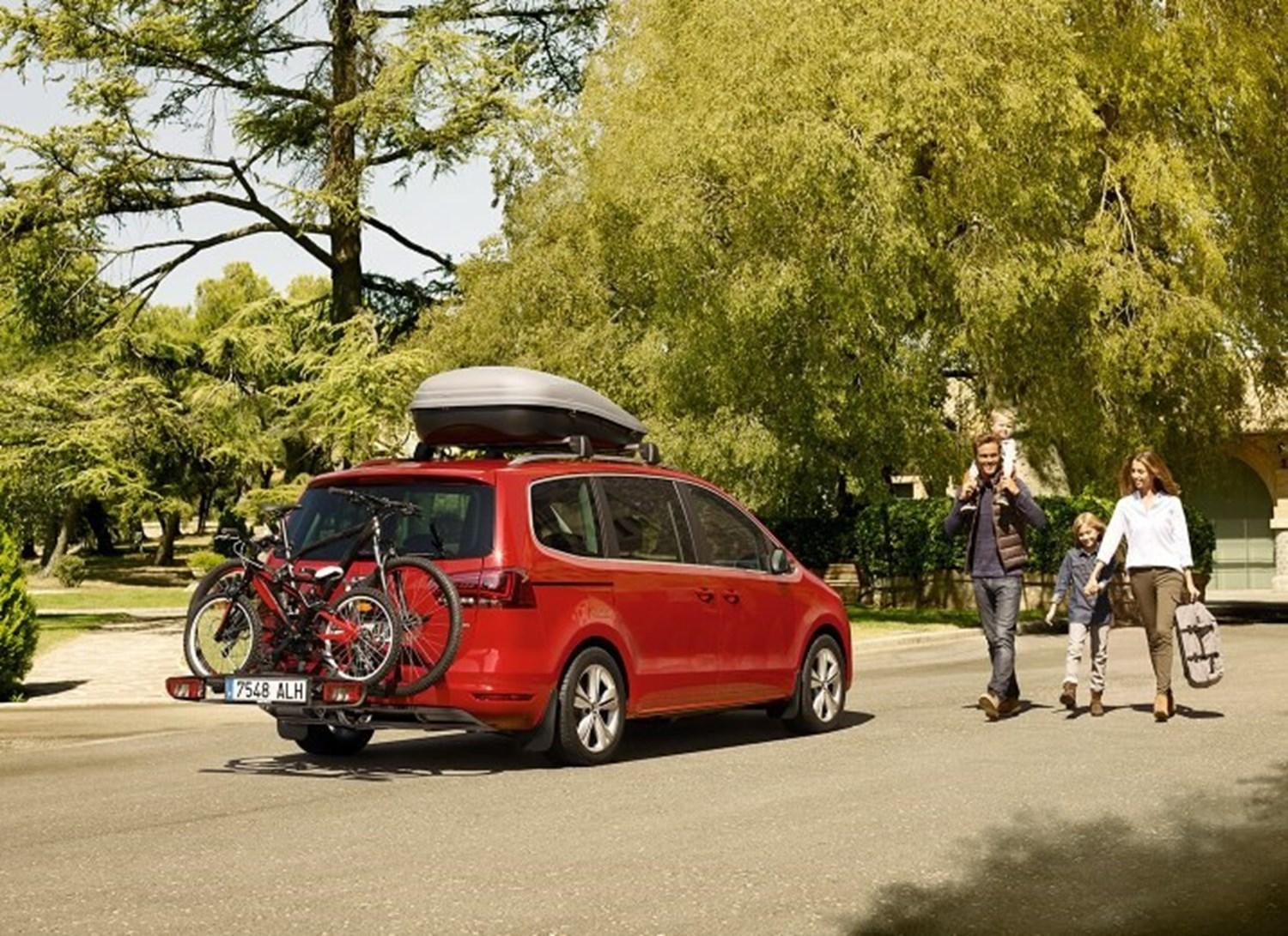 Red SEAT Alhambra with bike rack and roof rack