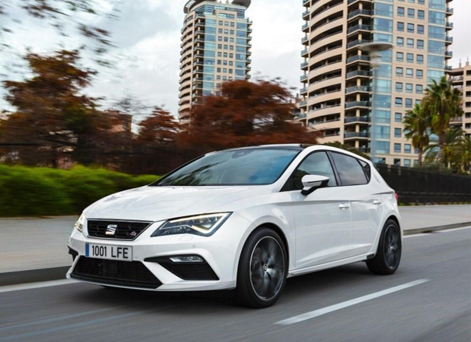 White SEAT Ibiza FR with flats in the background
