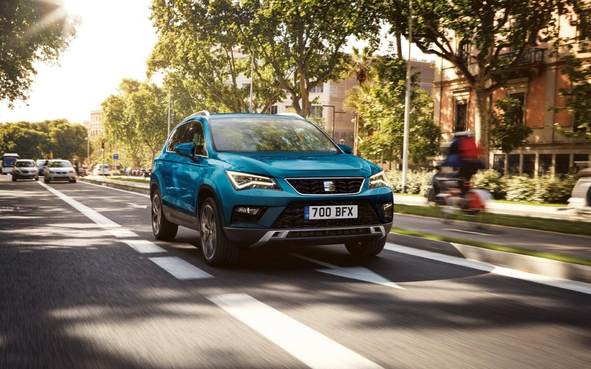 Blue SEAT Arona on town road