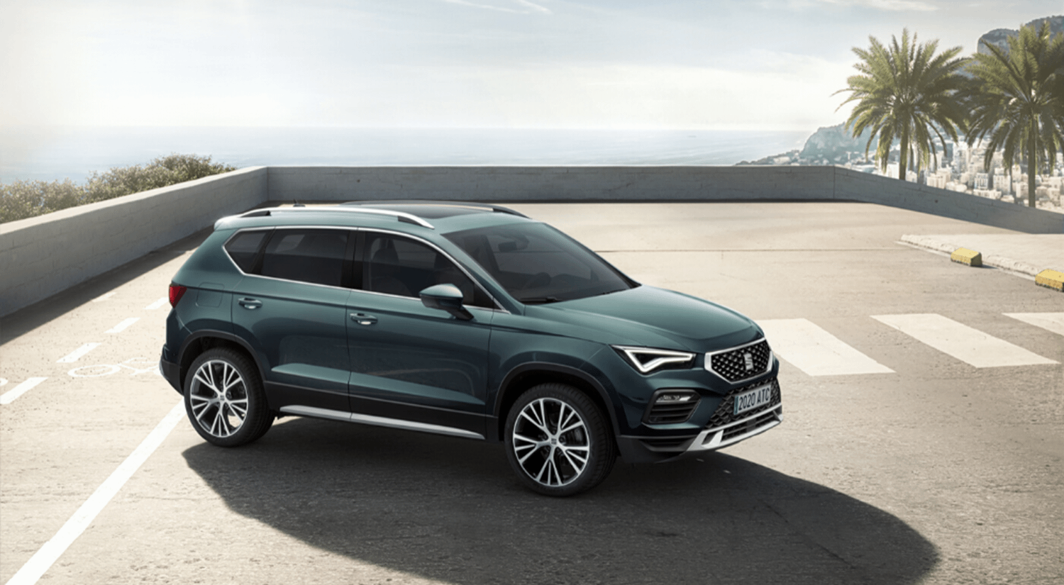 Green SEAT Ateca parked on rooftop carpark