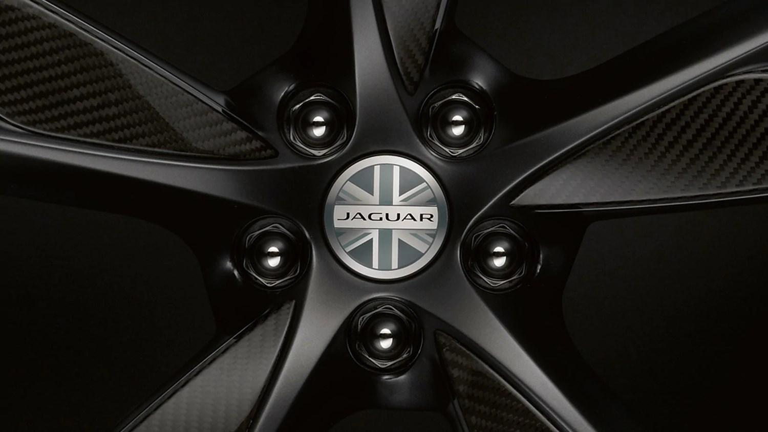Close up of Jaguar alloy wheel with union jack on it