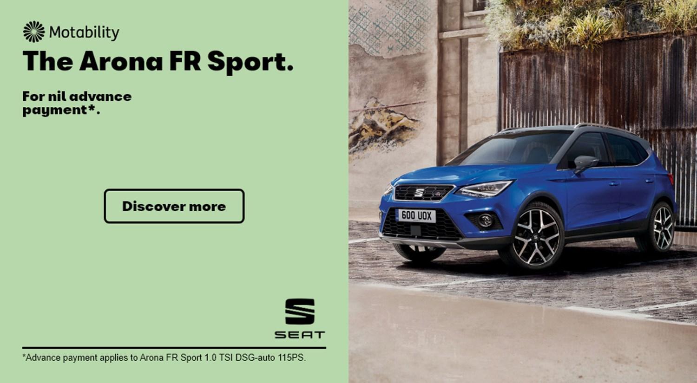 Blue SEAT Arona FR Sport parked in car park Motability banner