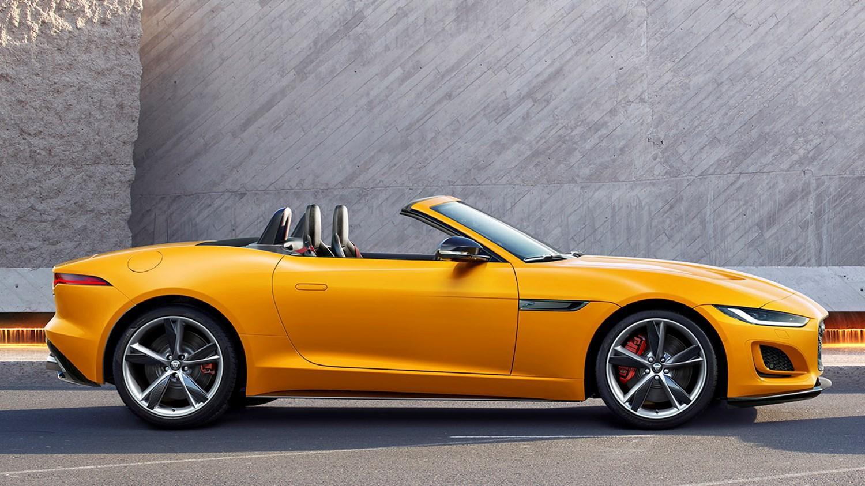 Yellow Jaguar Cabriolet parked side profile view