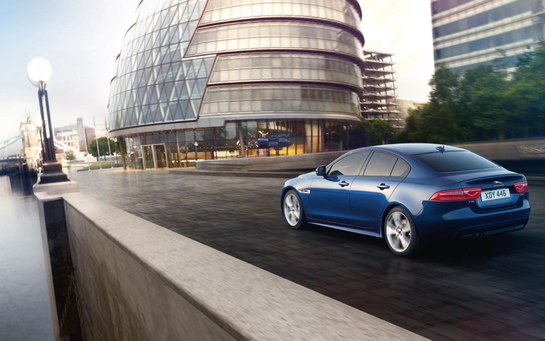 Blue Jaguar Driving down the road