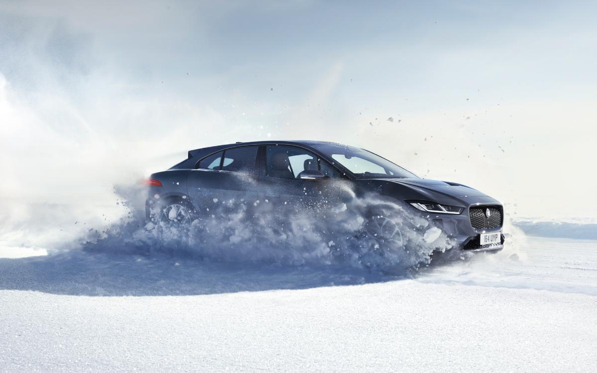 Jaguar I-Pace driving through snow