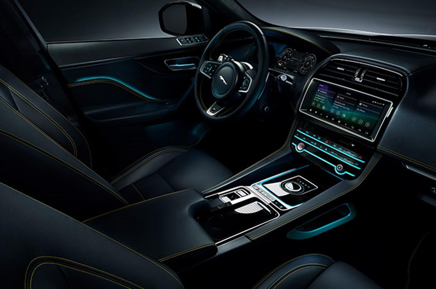Jaguar interior dashboard and central console with blue illuminating lights