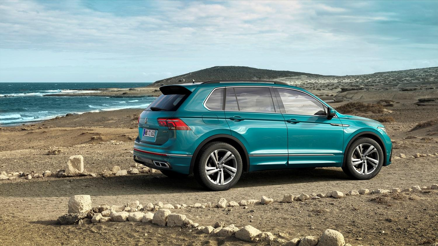 Turquoise Tiguan parked by the sea