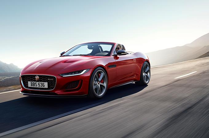 Red Jaguar Cabriolet driving on the open road