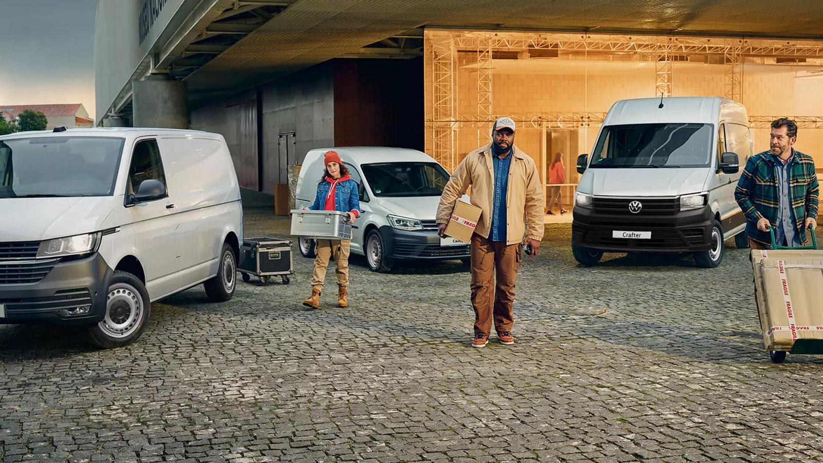 Delivery people with their range of Volkswagen vans