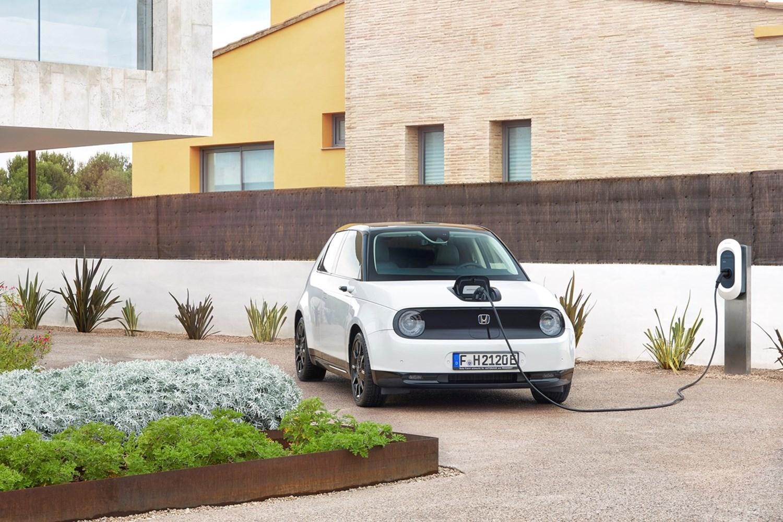 White Honda e charging