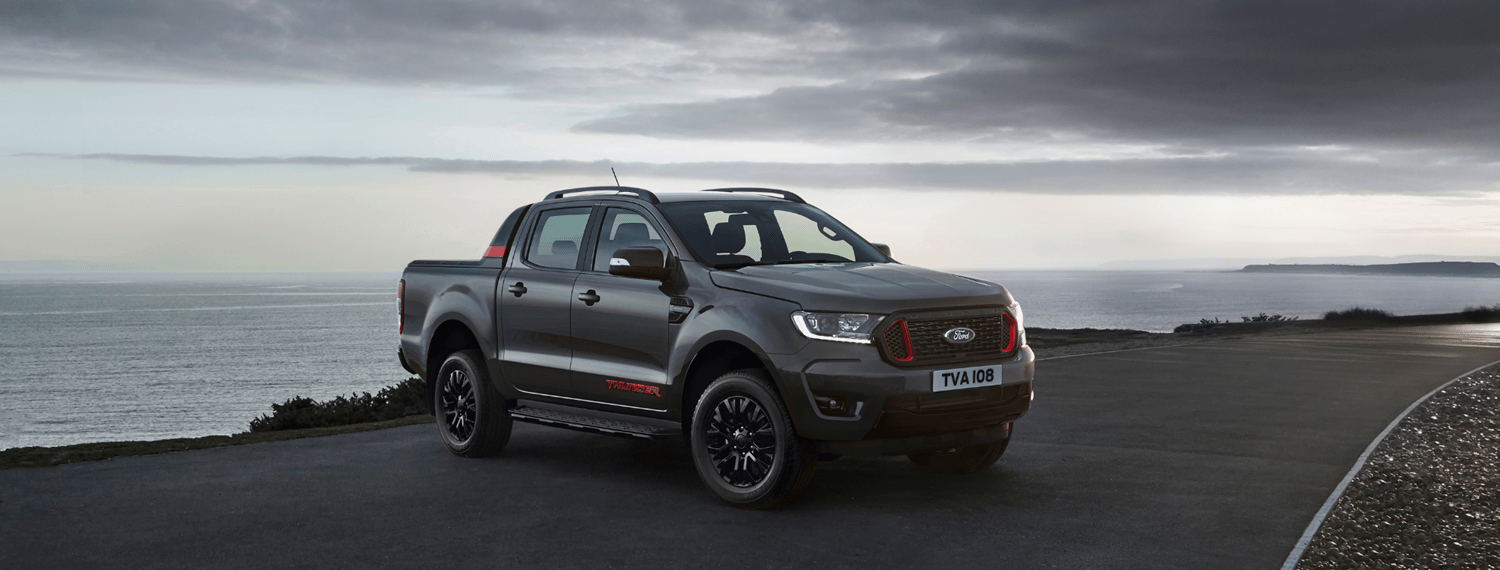 New Ford Ranger Thunder in Grey parked by sea