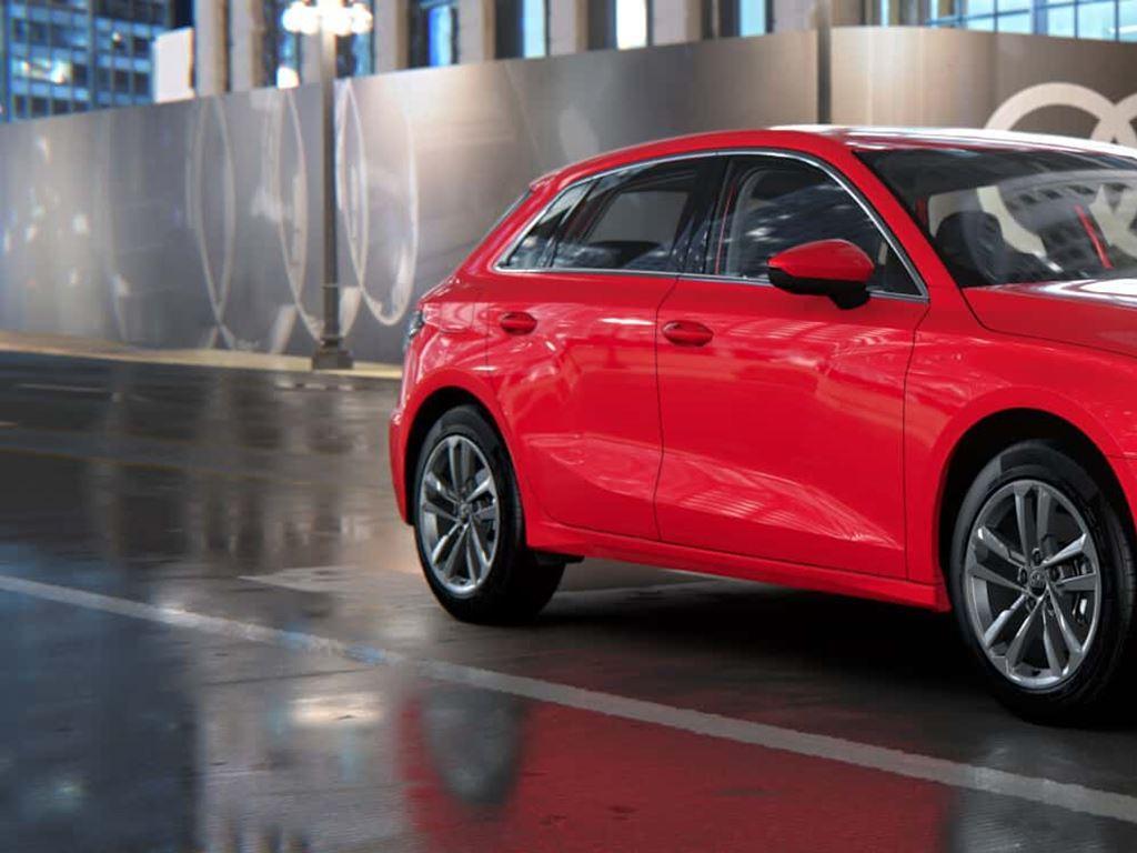 New Red Audi A3 Sportback TFSI e on road
