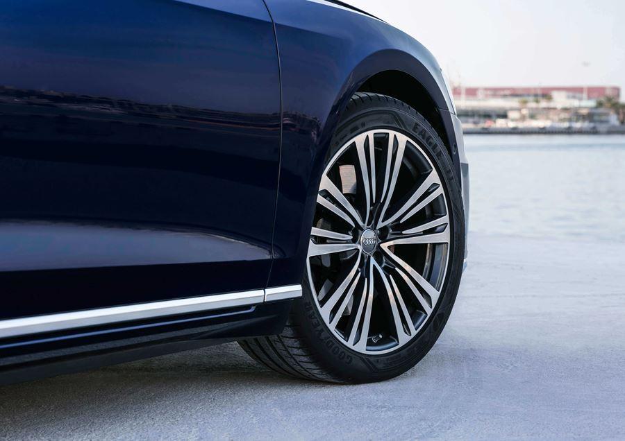 Close up of Audi wheel on dark blue Audi