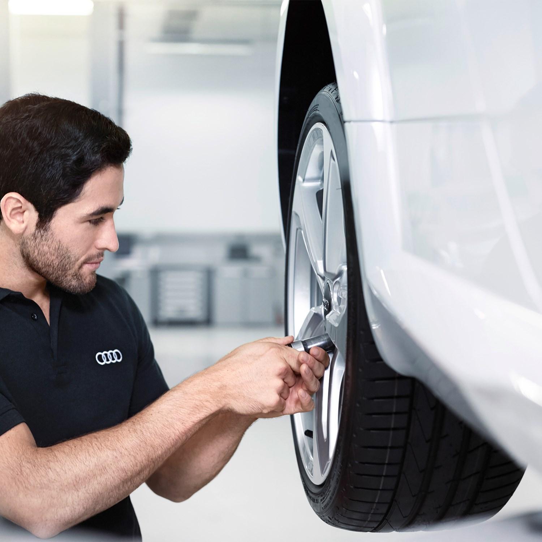 Mechanic Working on vehicles wheel