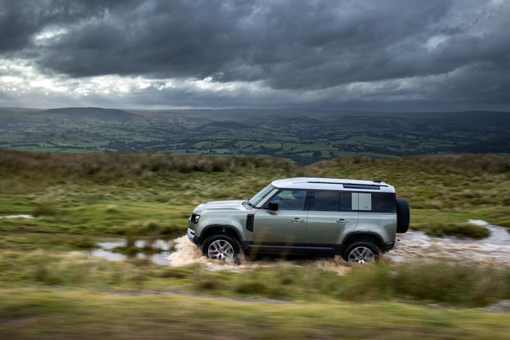 Land Rover Defender driving through stream