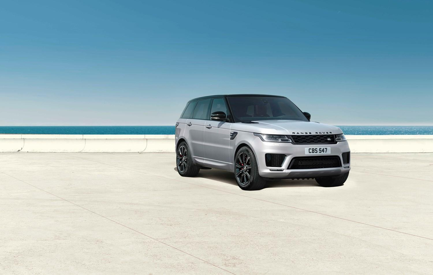 silver range rover sport parked with sea behind