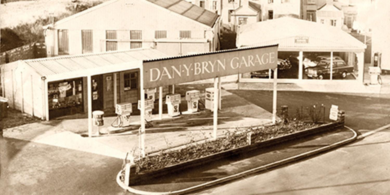 Black and white image of old car dealership
