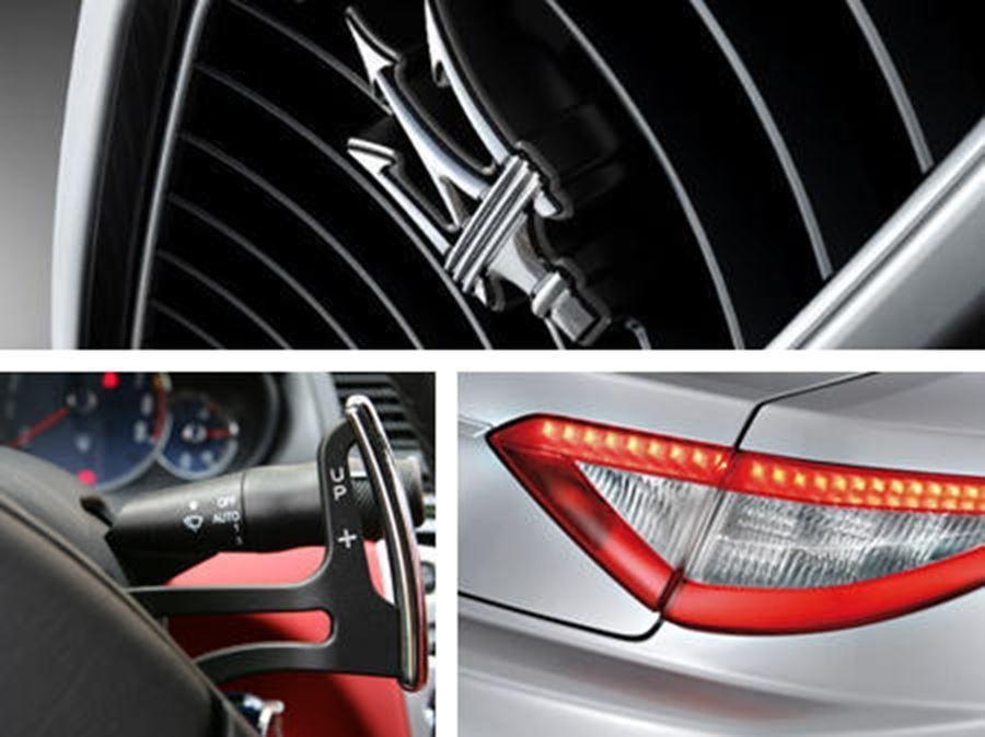 close up of maserati badge, lights and pedals