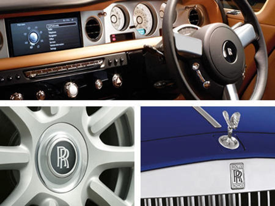 close up of Spirit of Ecstasy, alloy and steering wheel