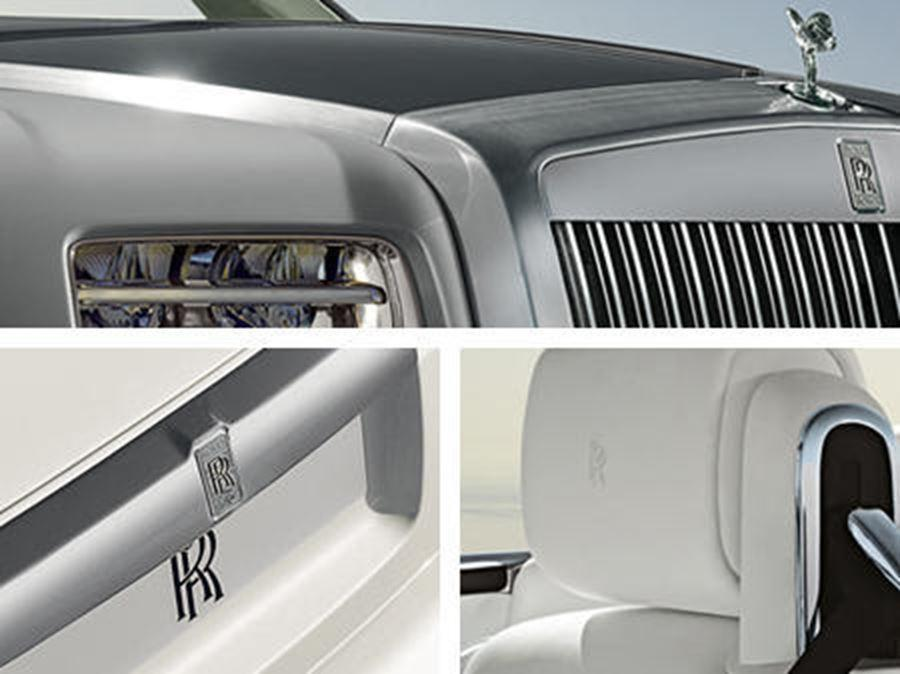 close up of rolls-royce head rest, front and badge