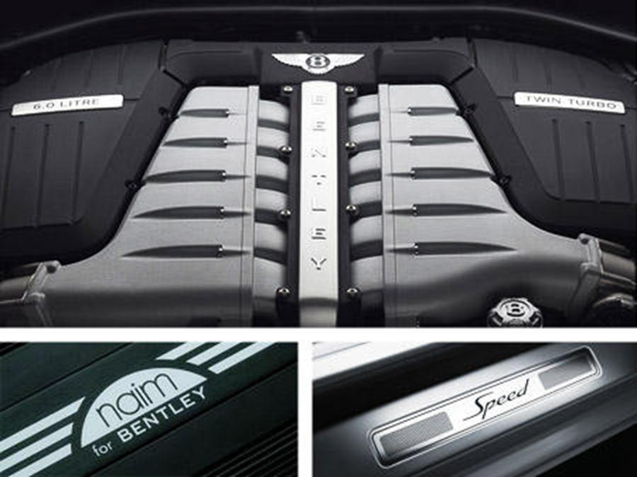 close up of bentley badges and engine